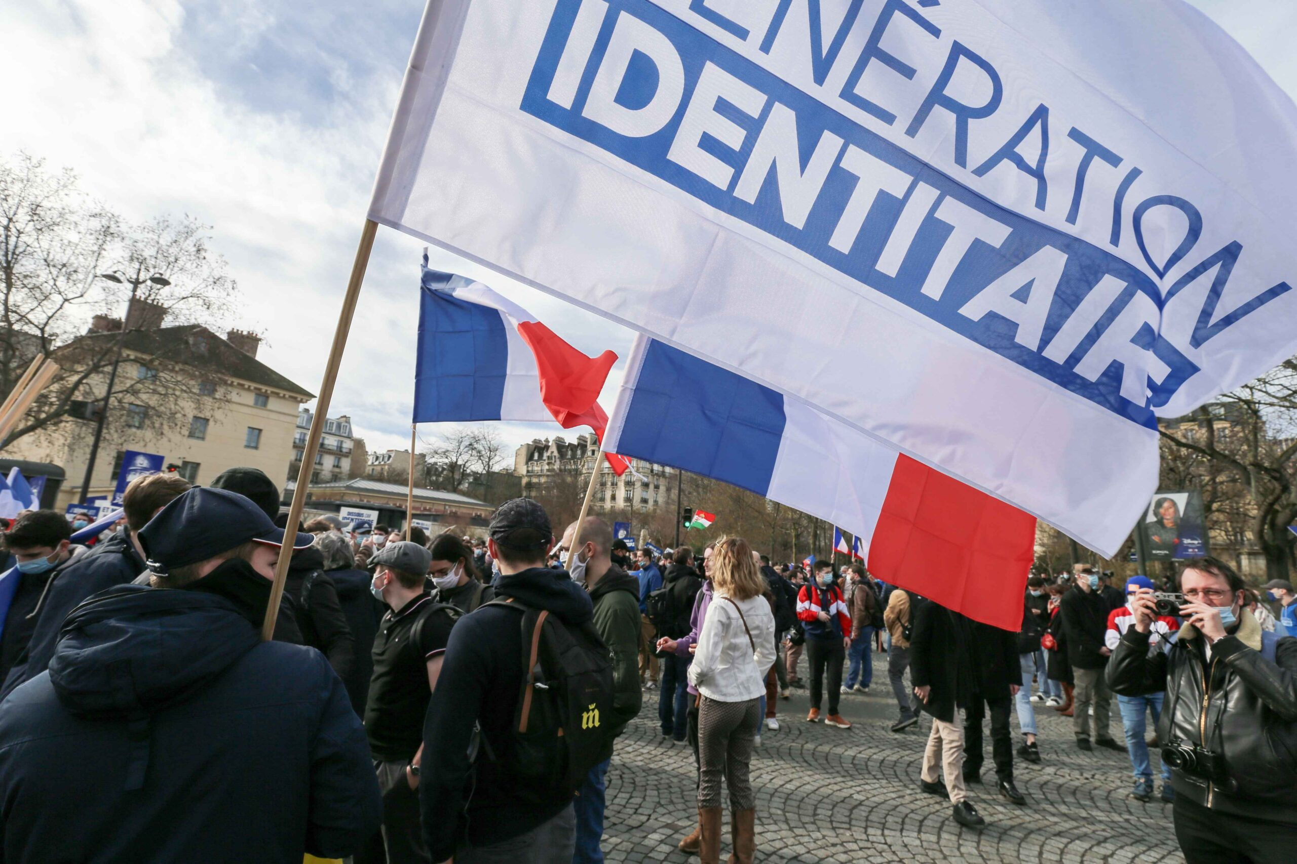 Members and supporters of far right group Generation Identitaire (GI) hold banners and placards during a protest against its potential dissolution in Place Denfert Rochereau, in Paris on February 20, 2021. The dissolution of Generation identitaire was evok