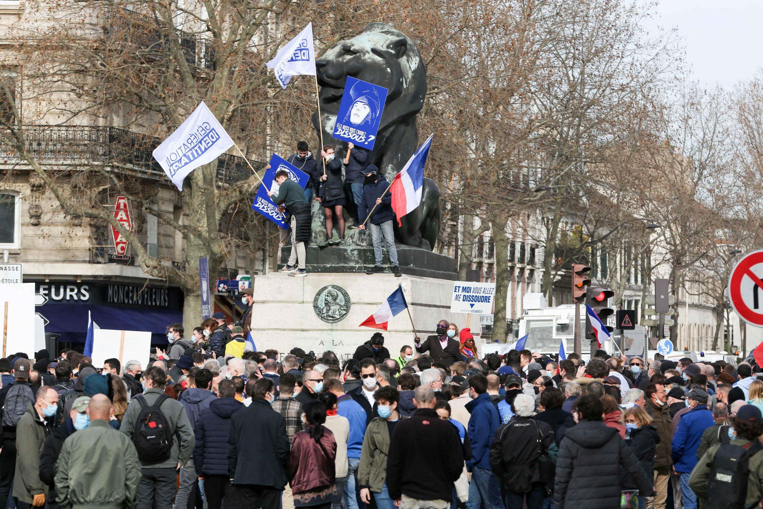 Members and supporters of far right group Generation Identitaire (GI) hold banners and placards during a protest against its potential dissolution in Place Denfert Rochereau, Paris on February 20, 2021. The dissolution of Generation identitaire was evoked