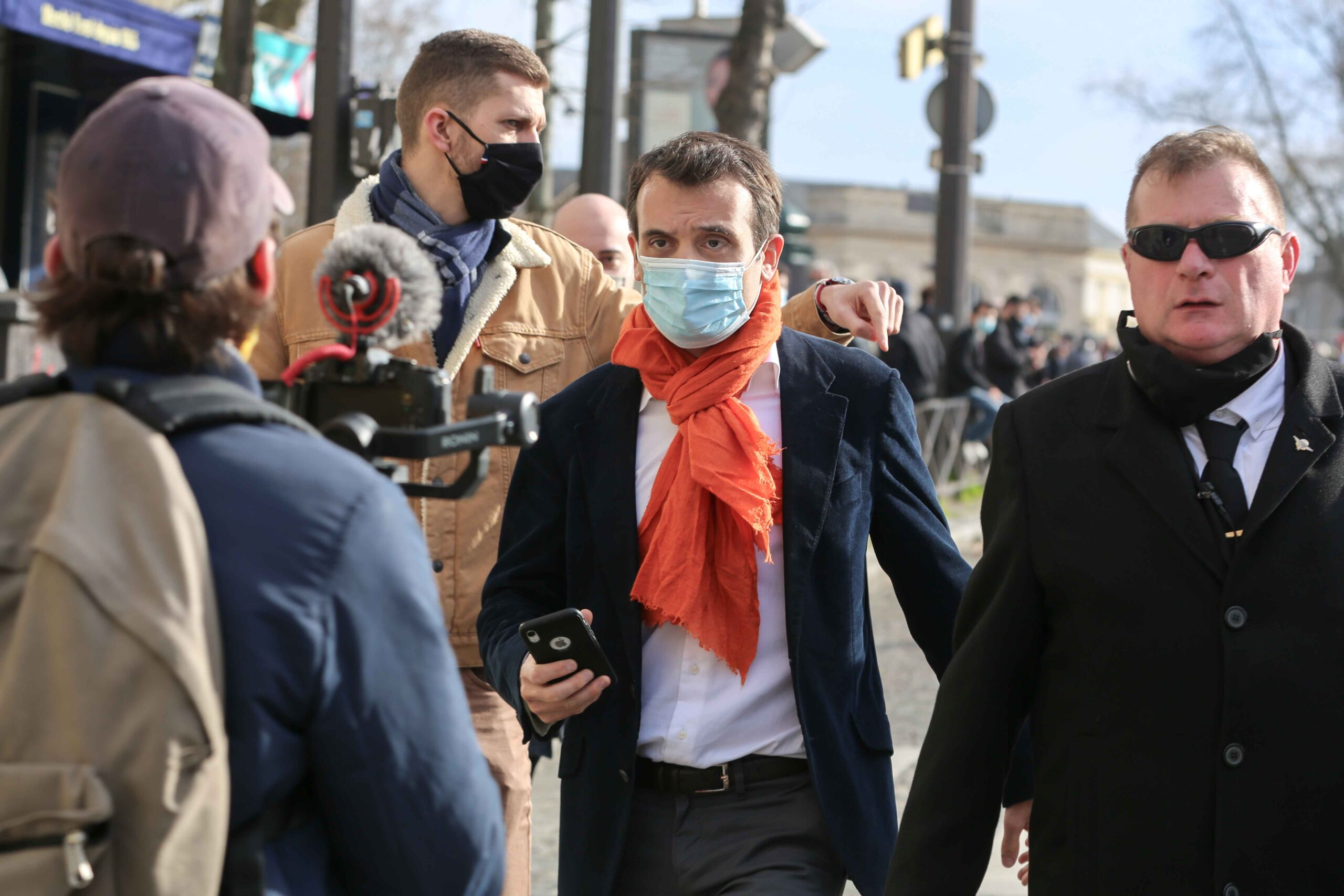 "President of French nationalist party ""Les Patriotes"" (The Patriots) Florian Philippot (C) takes part in a demonstration of members and supporters of far right group Generation Identitaire (GI) against the group's potential dissolution in Place Denfert Roc"
