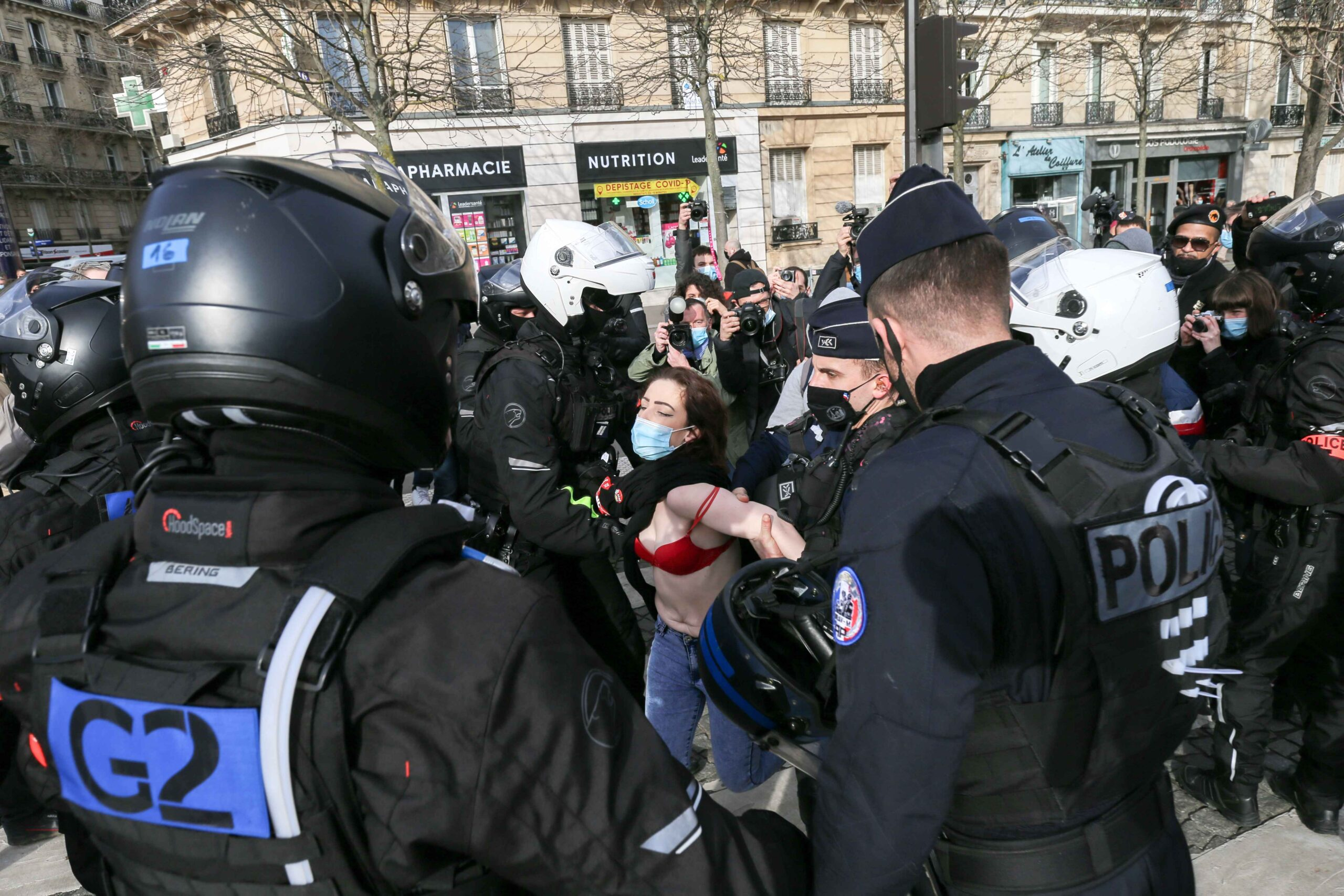Policemen push off an « anti-fascist » counterprotest, during a demonstration against the far right Generation Identitaire group's potential dissolution in Place Denfert Rochereau, in Paris on February 20, 2021. The dissolution of Generation identitaire